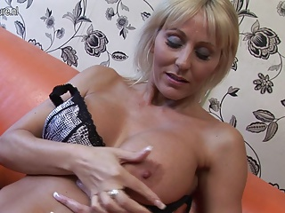 Hot British cougar mom playing with her pussy
