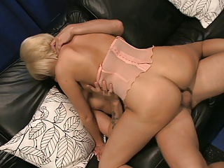 Busty whore gets fucked in the ass while her nipples are licked