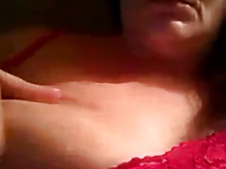 MILF playing with her nipple