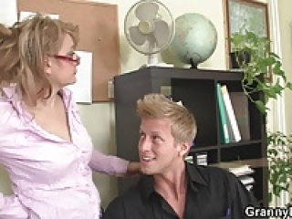 Guy fucks mature office woman on the floor