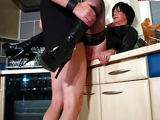 Hot Cougar In Leather and Boots Gets It In Kitchen